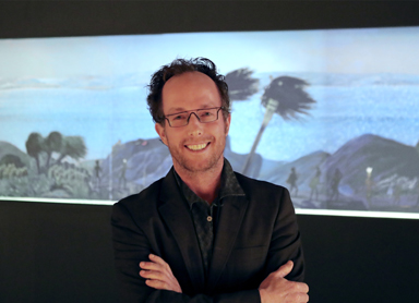 Perth Media Artist Sohan Ariel Hayes with his work Panoramic View of Albany (Kinjarling), The Place of Rain (2019).