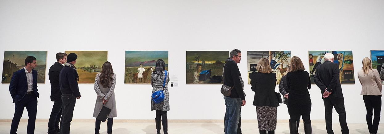 People viewing works by Sidney Nolan Ned Kelly series
