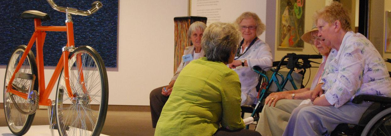 Elderly people visiting an exhibition